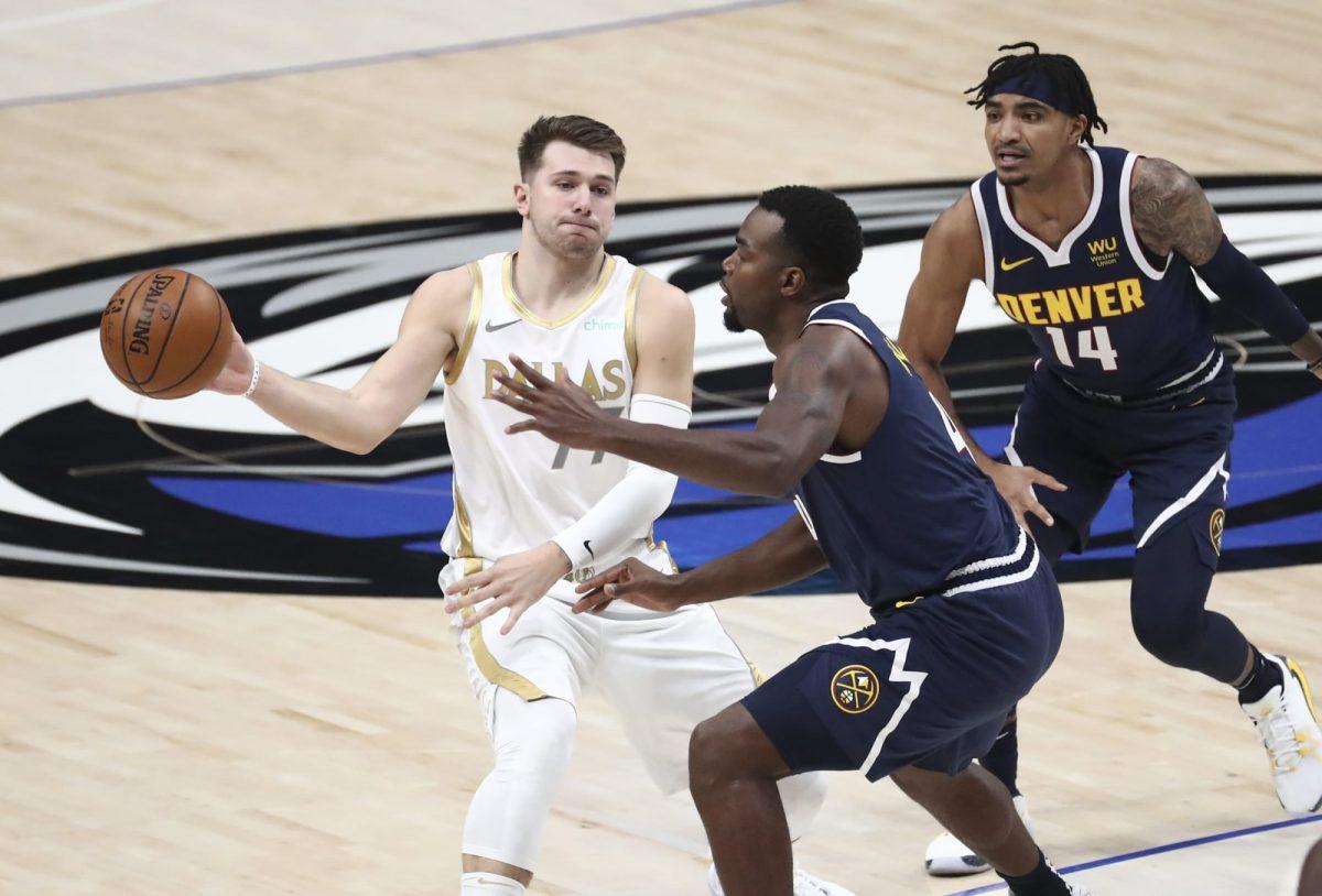 Luka Doncic contro la difesa dei Denver Nuggets